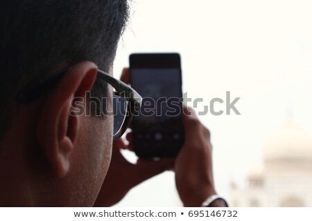 Young man clicking a selfie Stock photo © wavebreak_media
