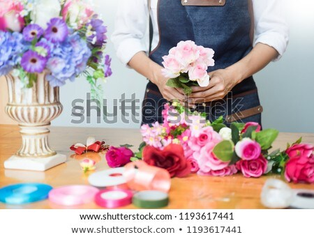 female florist at work using arranging making beautiful artifici stock photo © snowing