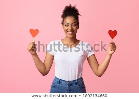 Szczęśliwy piękna kobieta stwarzające odizolowany różowy Zdjęcia stock © deandrobot