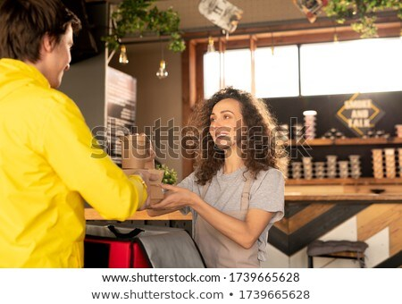 Group of friends looking at waiter serving food Stock photo © Kzenon