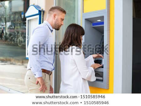 Man Spying For PIN Code While Woman Using An ATM Stock photo © AndreyPopov