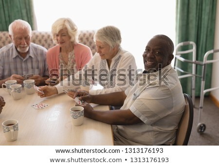 Front view of group of active senior people interacting with each other at nursing home Stock photo © wavebreak_media