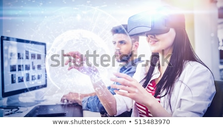 side view of young asian male executive using virtual reality headset standing in modern office stock photo © wavebreak_media