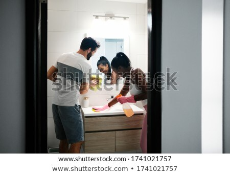 Mensen schoonmaken home badkamer Stockfoto © diego_cervo