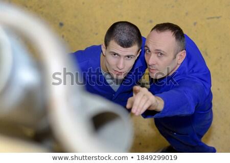 Pointing upwards workman Stock photo © photography33