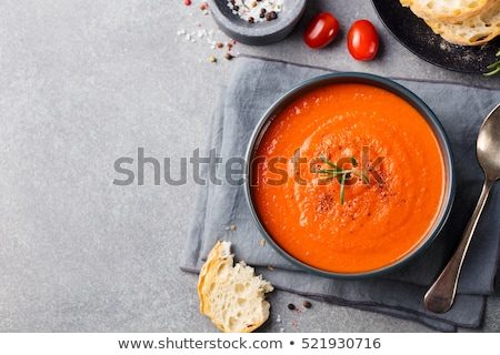 Tomato soup with cream and bread Stock photo © raphotos