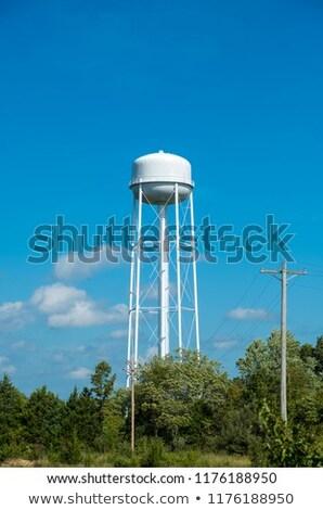 Blue sky with american water tank Stock photo © lunamarina