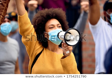 Displeased african woman Stock photo © deandrobot