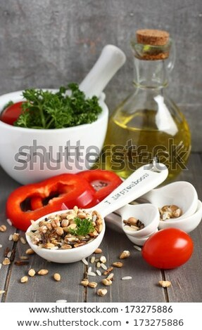 Uncooked multigrain rice in porcelain measuring spoons with raw vegetable Stock photo © Melnyk