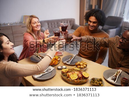 High angle view of happy multi-ethnic group of friends toasting with beer bottle at beach on a sunny Stock photo © wavebreak_media