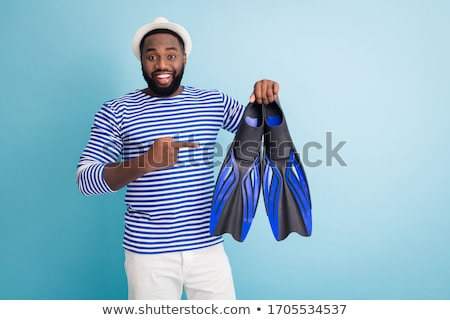 Image of young african american guy smiling and pointing finger  Stock photo © deandrobot