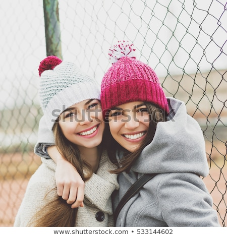 Image of young caucasian girl wearing hat and coat smiling at ca Stock photo © deandrobot