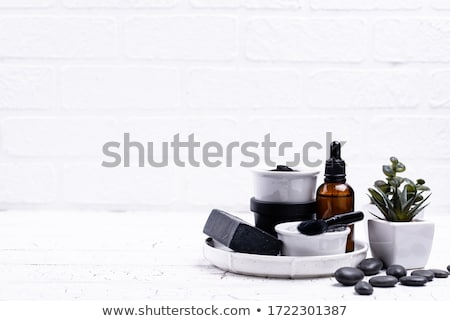 Conjunto preto carvão vegetal cosméticos Foto stock © furmanphoto