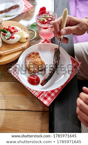 Dîner homme manger viande table Photo stock © Illia