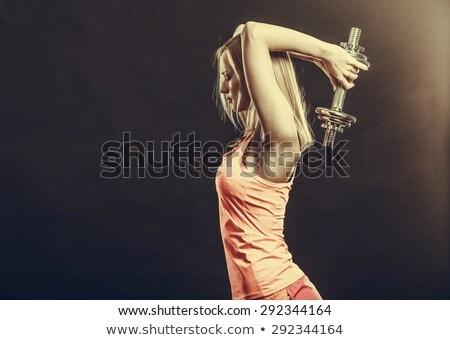 Girl lifting dumbbell, studio shot Stock photo © photography33