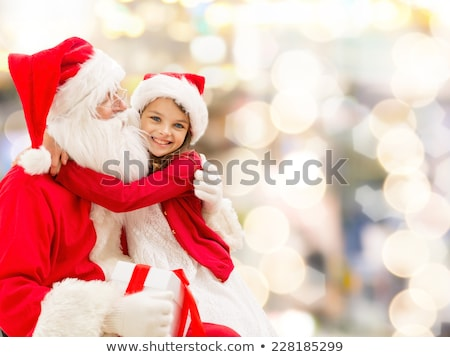 santa claus girl with red gift box stock photo © carlodapino