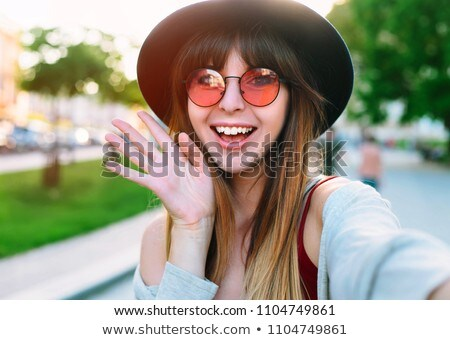 Teen girl with a photo camera. Stock photo © lithian