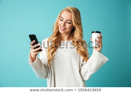 pretty young woman talking by phone while drinking coffee stock photo © deandrobot