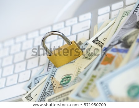 Security lock on dollar bills with white computer keyboard Stock photo © vlad_star