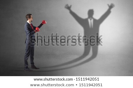 businessman fighting with a disarmed businessman shadow stock photo © ra2studio