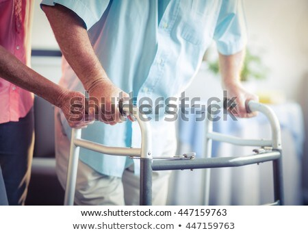Mid section of disabled senior woman walking with walker in garden on a sunny day Stock photo © wavebreak_media