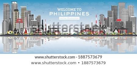 Manila Skyline with Gray Buildings, Blue Sky and Reflections. stock photo © ShustrikS