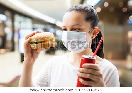 Femme potable soude visage masque à l'extérieur Photo stock © AndreyPopov