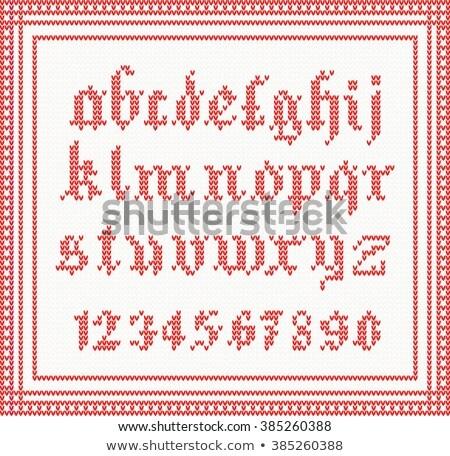 Natal fonte tricotado gótico alfabeto vermelho Foto stock © ShustrikS