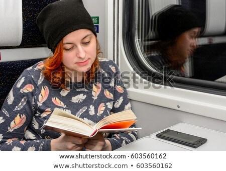 Kadın kırmızı kıvırcık saçlı okuma kitap göz Stok fotoğraf © Bananna
