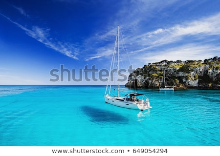 sailboat at tropical coast stock photo © ivonnewierink
