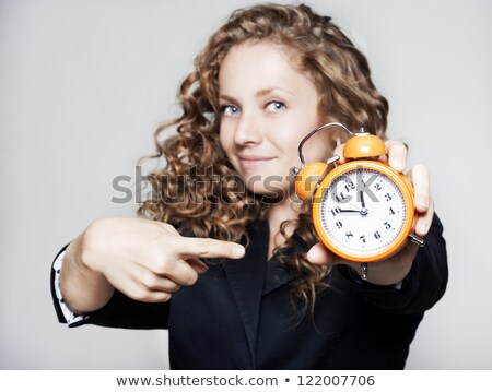 Tired businesswoman holding a clock stock photo © aremafoto