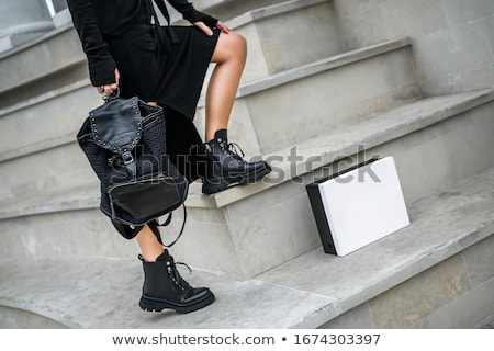 A pair of women's ankle boots and handbag Stock photo © Marmeladka