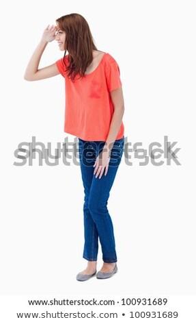 Adolescente olhando longe à frente mão acima Foto stock © wavebreak_media