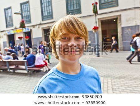 smart boy enjoys walking in the pedestrian zone  Stock photo © meinzahn