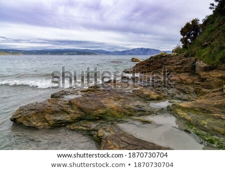Rocky coastal inlet with breaking waves Stock photo © stryjek