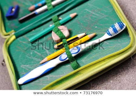 Aged pen box with teeth brush in Stock photo © zurijeta
