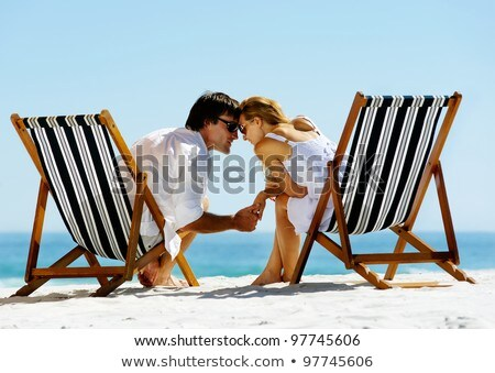 Young couple sharing a deck chair Stock photo © IS2