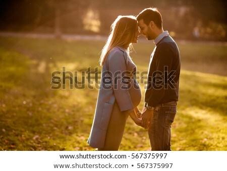 zwangere · vrouw · man · poseren · najaar · park · vrouw - stockfoto © boggy