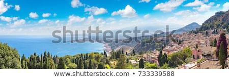Zeegezicht bergen panoramisch zonsondergang Geel Stockfoto © Kotenko