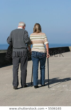 Father And Daughter's Hand On Walking Stick Stock photo © AndreyPopov