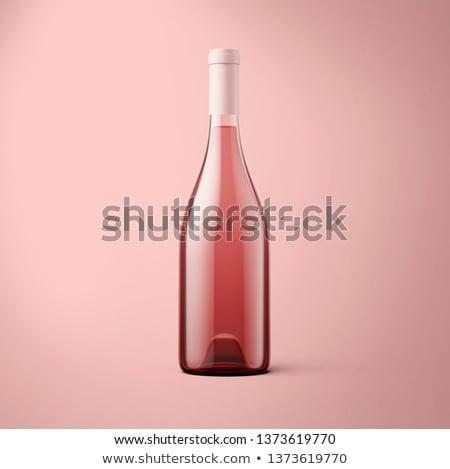 rose wine bottles and grapes stock photo © karandaev