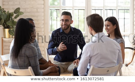 Smiling Group Of Young Friends Counseling Stock photo © AndreyPopov
