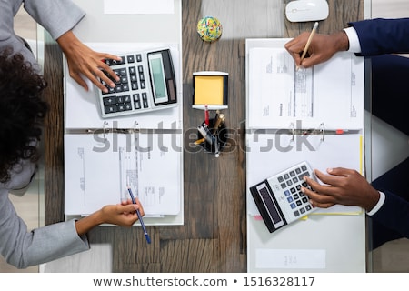 Two Business Colleagues Calculating Tax Stock photo © AndreyPopov
