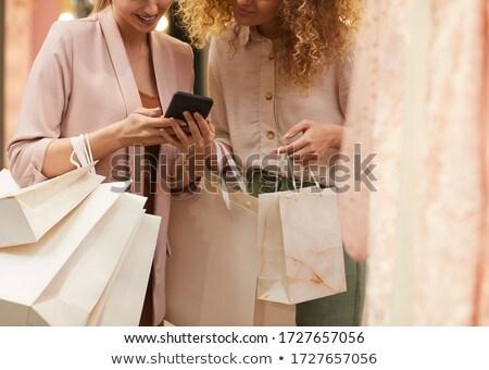 Középső rész gyönyörű fiatal nő mobiltelefon ül függőágy Stock fotó © wavebreak_media