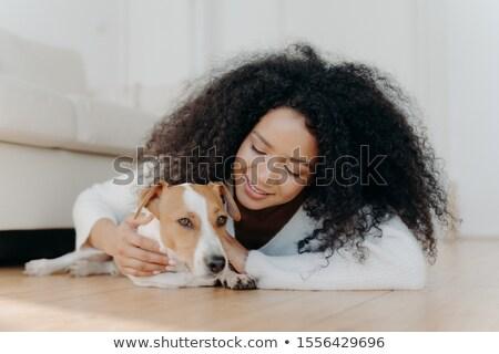 Africano mulher cabelo escuro mentiras piso Foto stock © vkstudio