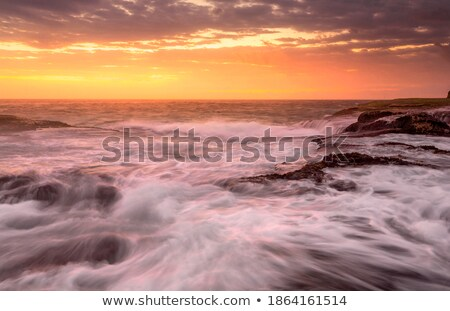 Ocean tides whipped up by gale winds Stock photo © lovleah