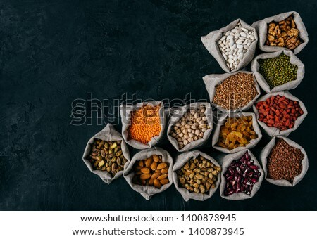 Horizontal shot of little sacks filled with almonds, walnuts, raisins, garbanzo, kidney bean, red go Stock photo © vkstudio