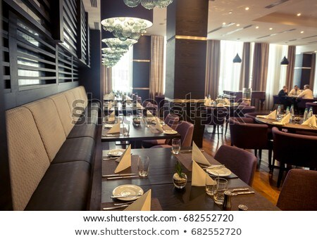 Chef seated in a restaurant Stock photo © photography33
