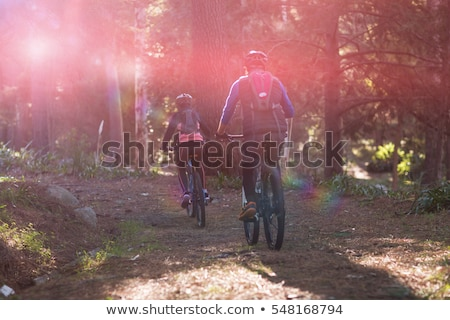 Stock photo: Rear view of biker couple cycling in countryside