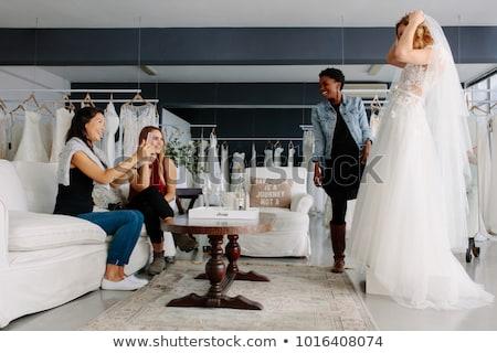 Smiling women looking at wedding dress Stock photo © wavebreak_media
